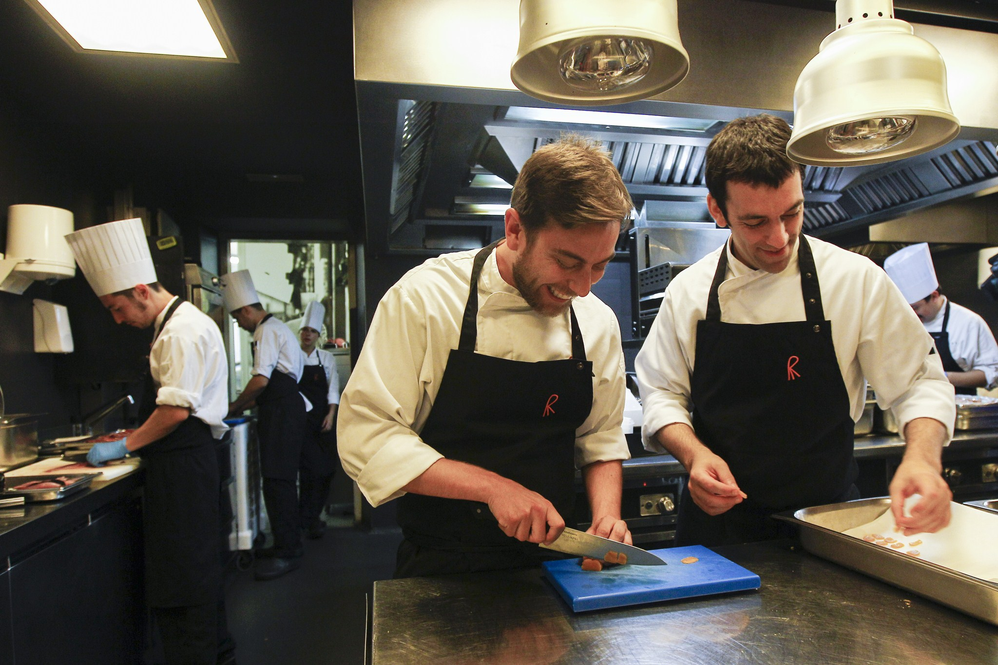 """Chefs of the restaurant """"El Celler de Can Roca"""" Spanish Nacho Baucells (L) and Argentinian Hernan Luchetti (R) work in the kitchen in Girona on June 2, 2015. Spain's """"El Celler de Can Roca"""" was crowned the world's best restaurant on June 1, 2015 winning praise for the """"collective genius"""" of the three brothers who run it. It was the second time the Girona eatery has topped the World's 50 Best Restaurant awards in London, after taking the number one spot in 2013.   AFP PHOTO/ QUIQUE GARCIA        (Photo credit should read QUIQUE GARCIA/AFP/Getty Images)"""
