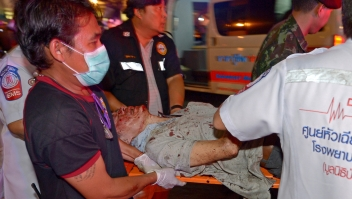 Thai rescue workers transport an injured person after a bomb exploded outside a religious shrine in central Bangkok late on August 17, 2015 killing at least 10 people and wounding scores more. Body parts were scattered across the street after the explosion outside the Erawan Shrine in the downtown Chidlom district of the Thai capital. AFP PHOTO / PORNCHAI KITTIWONGSAKUL (Photo credit should read PORNCHAI KITTIWONGSAKUL/AFP/Getty Images)