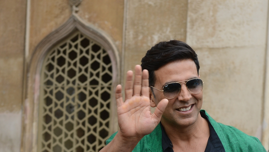 Indian Bollywood actor Akshay Kumar waves during a visit to the Charminar monument as he promotes his upcoming film BOSS in Hyderabad on October 11, 2013. AFP PHOTO / Noah SEELAM (Photo credit should read NOAH SEELAM/AFP/Getty Images)
