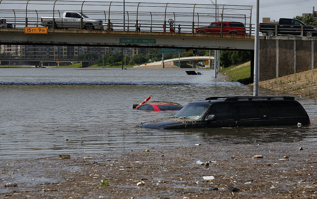 Vehicles are left stranded on Texas State Highway 288 in Houston, Texas on May 26, 2015. Heavy rains throught Texas put the city of Houston under massive amounts of water, closing roadways and trapping residents in their cars and buildings, according to local reports. Rainfall reached up to 11 inches (27.9cm) in some parts of the state, according to national forecasters, and the heavy rains quickly pooled over the state's already saturated soil. AFP PHOTO/AARON M. SPRECHER (Photo credit should read Aaron M. Sprecher/AFP/Getty Images)