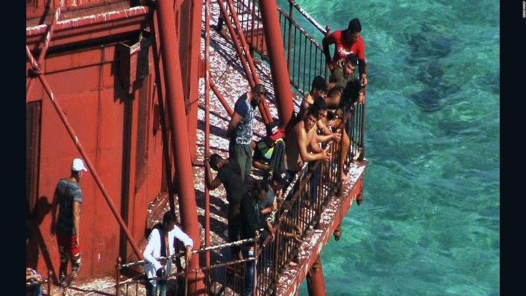 A lawsuit argues the group of migrants who fled Cuba in a homemade boat and climbed onto a 136-year-old lighthouse off the Florida Keys should be allowed to stay in the United States.