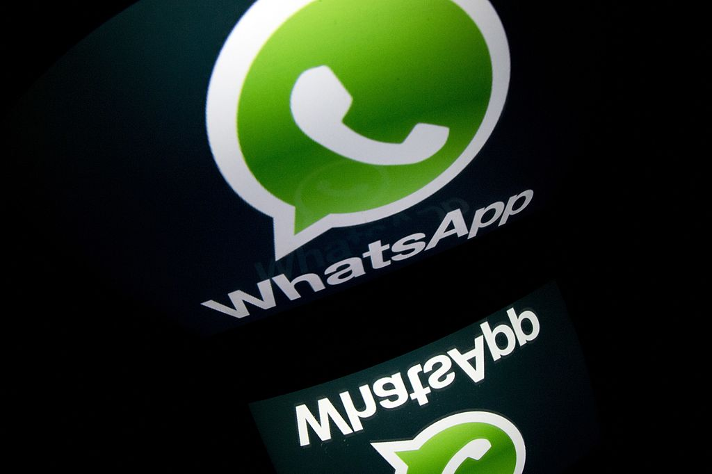 """The logo of mobile app """"WhatsApp"""" is displayed on a tablet on January 2, 2014 in Paris. AFP PHOTO / LIONEL BONAVENTURE (Photo credit should read LIONEL BONAVENTURE/AFP/Getty Images"""
