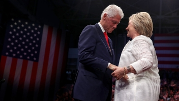 BROOKLYN, NY - JUNE 07: Democratic presidential candidate former Secretary of State Hillary Clinton (R) and her husband former U.S. president Bill Clinton embrace during a primary night event on June 7, 2016 in Brooklyn, New York. Hillary Clinton surpassed the number of delegates needed to become the democratic nominee over rival Bernie Sanders with a win in the New Jersey presidential primary (Photo by Justin Sullivan/Getty Images)