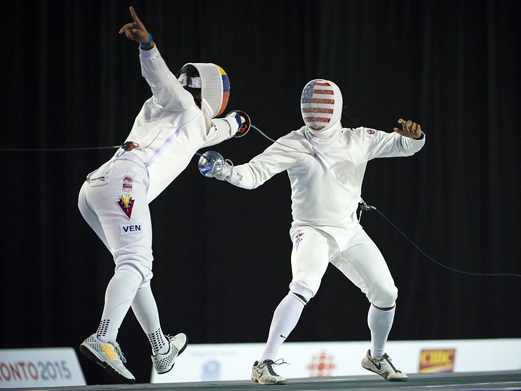 Ruben Limardo Gascon of Venezuela (L) competes against Jason Pryor of the US in the Men's Epee Individual Fencing event at the at the Pan American Games July 21, 2015 in Toronto, Canada. AFP PHOTO/KEVIN VAN PAASSEN        (Photo credit should read KEVIN VAN PAASSEN/AFP/Getty Images)