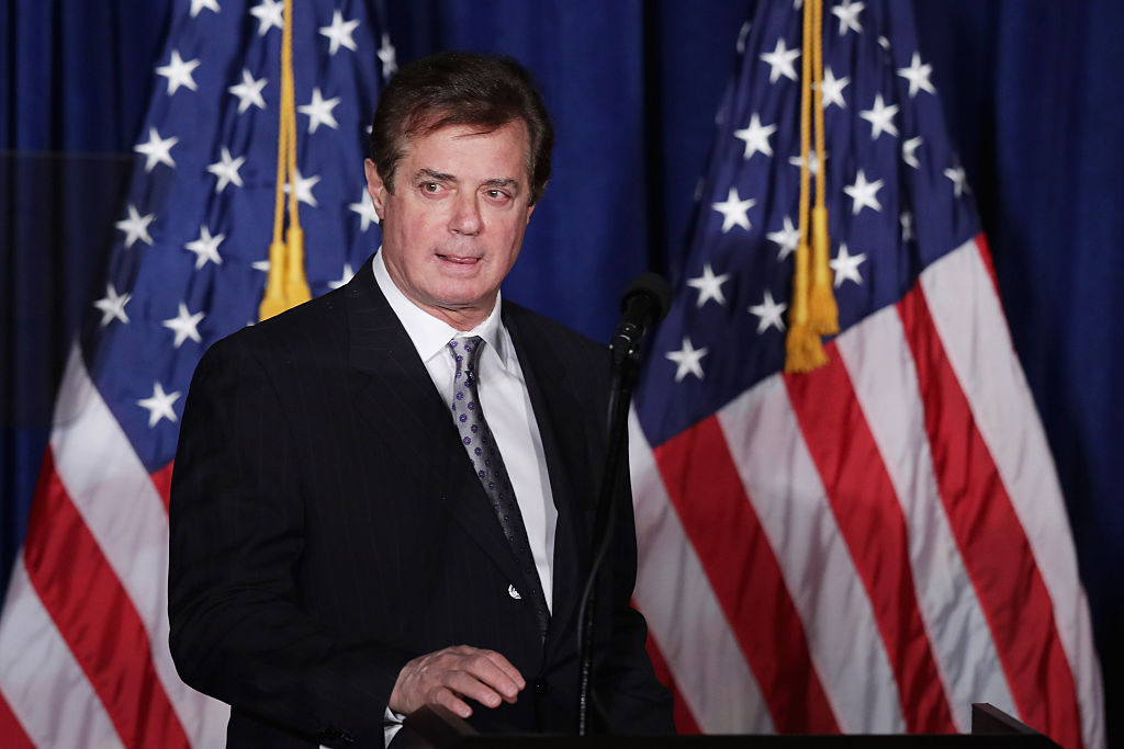 """WASHINGTON, DC - APRIL 27: Paul Manafort, advisor to Republican presidential candidate Donald Trump's campaign, checks the teleprompters before Trump's speech at the Mayflower Hotel April 27, 2016 in Washington, DC. A real estate billionaire and reality television star, Trump beat his GOP challengers by double digits in Tuesday's presidential primaries in Pennsylvania, Maryland, Deleware, Rhode Island and Connecticut. """"I consider myself the presumptive nominee, absolutely,"""" Trump told supporters at the Trump Tower following yesterday's wins. (Photo by Chip Somodevilla/Getty Images)"""