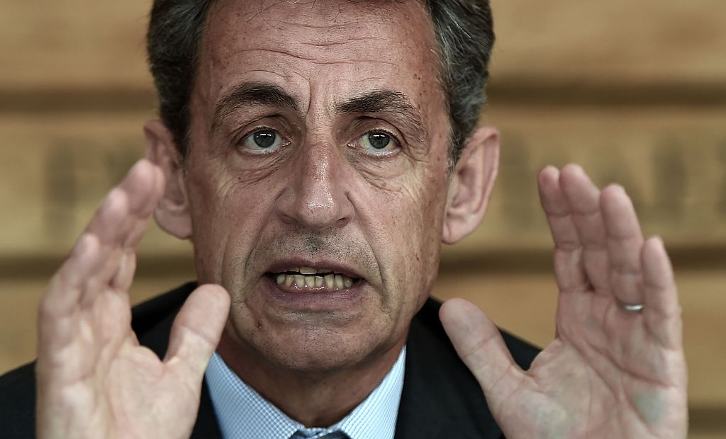 """Former French president and head of the right-wing opposition party """"Les Republicains"""" (The Republicans) Nicolas Sarkozy gestures while speaking during a meeting with farmers on July 9, 2016 in Kriegsheim, eastern France. / AFP / FREDERICK FLORIN (Photo credit should read FREDERICK FLORIN/AFP/Getty Images)"""
