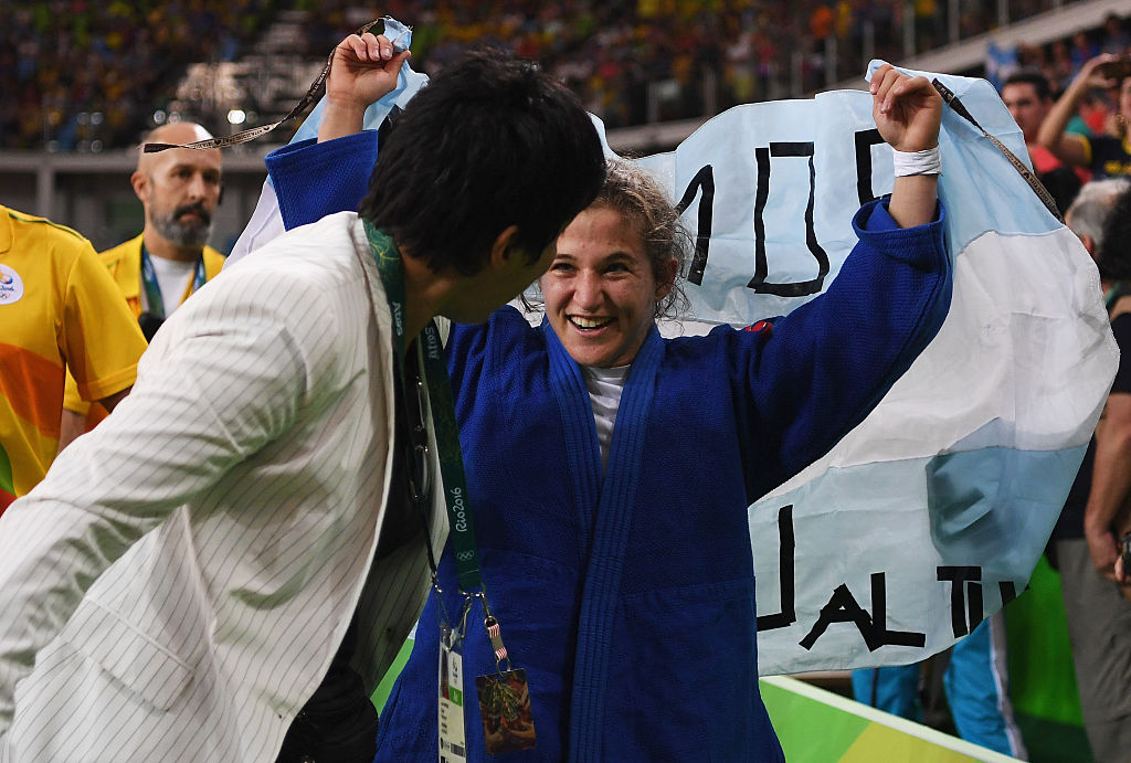 RIO DE JANEIRO, BRAZIL - AUGUST 06: Paula Pareto of Argentina celebrates after defeating Bokyeong Jeong of Korea in the Women's -48 kg Gold Medal contest on Day 1 of the Rio 2016 Olympic Games at Carioca Arena 2 on August 6, 2016 in Rio de Janeiro, Brazil. (Photo by Laurence Griffiths/Getty Images)
