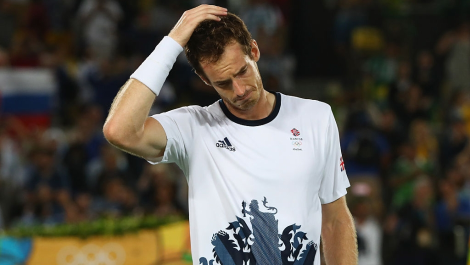 RIO DE JANEIRO, BRAZIL - AUGUST 14: Andy Murray of Great Britain reacts after victory in the men's singles gold medal match against Juan Martin Del Potro of Argentina on Day 9 of the Rio 2016 Olympic Games at the Olympic Tennis Centre on August 14, 2016 in Rio de Janeiro, Brazil. (Photo by Clive Brunskill/Getty Images)