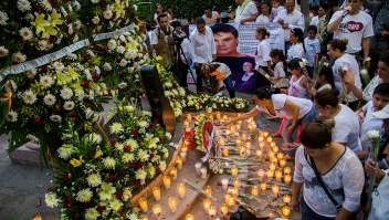 "Candles and flowers are seen in an altar at the feet of a statue of Mexican composer and singer Alberto Aguilera, known as ""Juan Gabriel"" in Paracuaro, Michoacan state, Mexico on August 29, 2016. Mexico and the music world on Monday mourned the death of legendary singer Juan Gabriel, who touched millions with wrenching ballads of love and loneliness as he rose from the rough streets of Ciudad Juarez to a world stage. / AFP / ENRIQUE CASTRO (Photo credit should read ENRIQUE CASTRO/AFP/Getty Images)"
