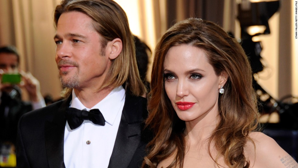 HOLLYWOOD, CA - FEBRUARY 26: Actor Brad Pitt (L) and actress Angelina Jolie arrive at the 84th Annual Academy Awards at the Hollywood & Highland Center February 26, 2012 in Hollywood, California. (Photo by Ethan Miller/Getty Images)