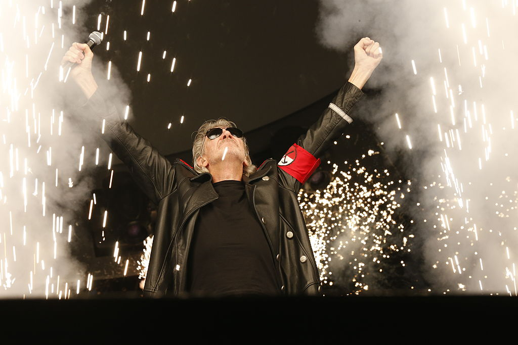 """British singer Roger Waters performs on stage during """"The Wall Live"""" tour at the Stade-de-France stadium in Saint-Denis, on September 21, 2013. THOMAS SAMSON / AFP PHOTO (Photo credit should read THOMAS SAMSON/AFP/Getty Images)"""