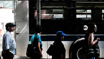 NEW YORK, NY - AUGUST 29: People wait for a bus in the ethnically diverse neighborhood of Queens on August 29, 2016 in New York City. Queens County is one of the five most diverse counties in the United States with a large Latino and Asian population among other groups. Immigration has once again become a topic dividing the candidates in the upcoming U.S. presidential election. Republican presidential candidate Donald Trump, who has been an advocate of building a wall with Mexico and deporting all illegal immigrants, is expected to give a speech on Wednesday to clarify his positions on immigration policy. (Photo by Spencer Platt/Getty Images)