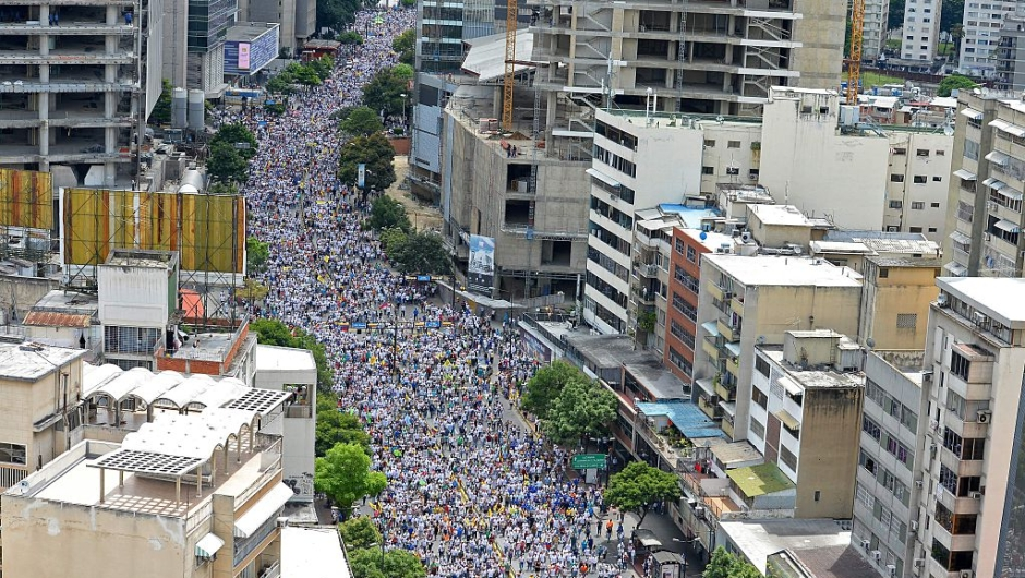 Opposition activists march in Caracas, on September 1, 2016. Venezuela's opposition and government head into a crucial test of strength Thursday with massive marches for and against a referendum to recall President Nicolas Maduro that have raised fears of a violent confrontation. / AFP / FEDERICO PARRA (Photo credit should read FEDERICO PARRA/AFP/Getty Images)