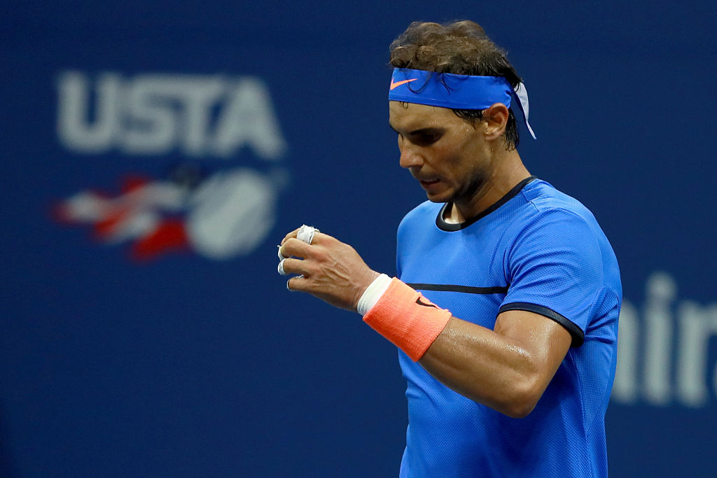 NEW YORK, NY - SEPTEMBER 04: Rafael Nadal of Spain reacts against Lucas Pouille of France during his fourth round Men's Singles match on Day Seven of the 2016 US Open at the USTA Billie Jean King National Tennis Center on September 4, 2016 in the Flushing neighborhood of the Queens borough of New York City. (Photo by Michael Reaves/Getty Images)