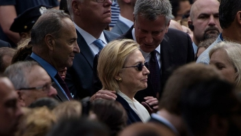 TOPSHOT - New York City Mayor Bill de Blasio speaks to US Democratic presidential nominee Hillary Clinton during a memorial service at the National 9/11 Memorial September 11, 2016 in New York. The United States on Sunday commemorated the 15th anniversary of the 9/11 attacks. / AFP / Brendan Smialowski (Photo credit should read BRENDAN SMIALOWSKI/AFP/Getty Images)