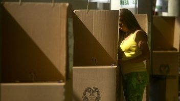 A woman votes in the presidential election on May 25, 2014, in Medellin, Antioquia department, Colombia. AFP PHOTO/Raul ARBOLEDA (Photo credit should read RAUL ARBOLEDA/AFP/Getty Images)