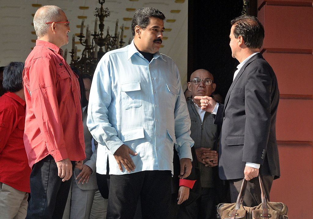 Venezuelan President Nicolas Maduro (C) speaks with the head negotiators of the Colombian government Frank Pearl, next to country's ELN left-wing guerrilla Eliecer Herlinton Chamorro Acosta, aka Antonio Garcia (L) at the end of a meeting at Miraflores presidential palace in Caracas on March 30, 2016. These talks would open a new front in peace negotiations as the government also closes in on a deal with the country's biggest guerrilla group, the Revolutionary Armed Forces of Colombia (FARC). The complex conflict between right- and left-wing guerrillas, government troops and gangs in Colombia is considered the last major armed confrontation in the Western Hemisphere. AFP PHOTO / FEDERICO PARRA / AFP / FEDERICO PARRA (Photo credit should read FEDERICO PARRA/AFP/Getty Images)