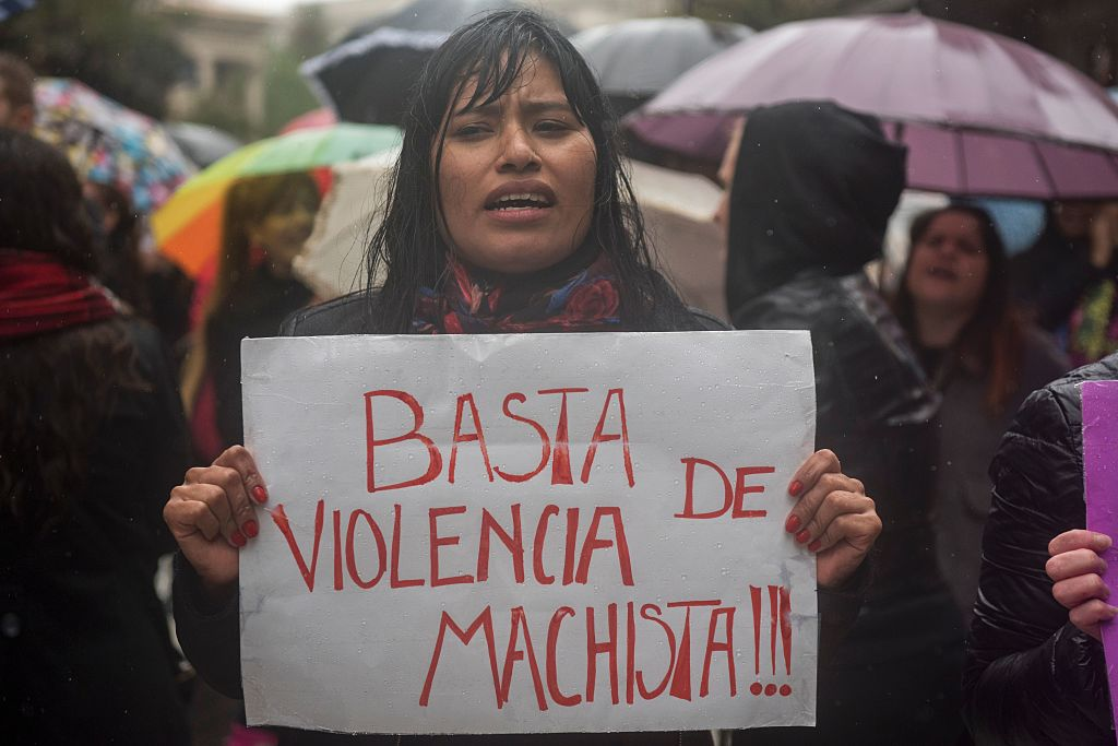 """Women stop work and other activities for an hour to join a """"women's strike"""" organized after the brutal killing of a 16-year-old girl, in Buenos Aires, on October 19, 2016. The brutal killing of a teenager who was allegedly raped and impaled on a spike by drug dealers has sparked outrage in Argentina. Lucia Perez, a high school student in the resort city of Mar del Plata, died on October 8 after being brought to the hospital by two men who said she had overdosed on drugs. But after doctors noticed signs of violent sexual penetration, investigators pieced together a different story. / AFP / Eitan ABRAMOVICH (Photo credit should read EITAN ABRAMOVICH/AFP/Getty Images)"""