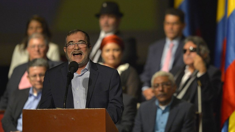 Head of the FARC guerrilla Timoleon Jimenez, aka Timochenko (front), delivers a speech after the signing of the historic peace agreement between the Colombian government and the Revolutionary Armed Forces of Colombia (FARC), at the Colon Theater in Bogota, Colombia, on November 24, 2016. Under pressure for fear that a fragile ceasefire could break down, the government and the Revolutionary Armed Forces of Colombia (FARC) sign the new deal and immediately take it to Congress. The plan bypasses a vote by the Colombian people after they unexpectedly rejected the first version of the deal in a referendum last month. The accord aims to end Latin America's last major armed conflict. But opponents say it is too soft on the leftist FARC force, blamed for many thousands of killings and kidnappings. / AFP / LUIS ROBAYO (Photo credit should read LUIS ROBAYO/AFP/Getty Images)