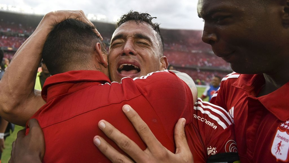 America de Cali's team player Camilo Ayala celebrates after defeating Deportes Quindio in a Colombian Professional Football tournament promotion match in Cali, Colombia, on November 27, 2016. America de Cali defeated Deportes Quindio by 2-1 and returned to first division after five years. / AFP / LUIS ROBAYO (Photo credit should read LUIS ROBAYO/AFP/Getty Images)