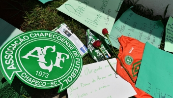 People pay tribute to the players of Brazilian team Chapecoense Real who were killed in a plane accident in the Colombian mountains, at the club's Arena Conda stadium in Chapeco, in the southern Brazilian state of Santa Catarina, on November 29, 2016. Players of the Chapecoense were among 81 people on board the doomed flight that crashed into mountains in northwestern Colombia, in which officials said just six people were thought to have survived, including three of the players. Chapecoense had risen from obscurity to make it to the Copa Sudamericana finals scheduled for Wednesday against Atletico Nacional of Colombia. / AFP / Nelson ALMEIDA (Photo credit should read NELSON ALMEIDA/AFP/Getty Images)