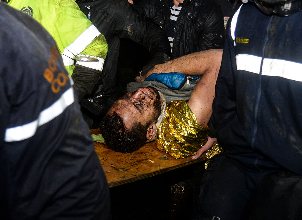 Brazil's Chapecoense player Helio Neto is helped by paramedics in la Union, Antioquia Department on November 29, 2016 after being rescued from the wreckage of the LAMIA airlines charter that crashed in the mountains of Cerro Gordo, municipality of La Union, Colombia, carrying the whole Brazilian team. A charter plane carrying the Brazilian football team crashed in the mountains in Colombia late Monday, killing as many as 75 people, officials said. / AFP / STR / Raul ARBOLEDA (Photo credit should read RAUL ARBOLEDA/AFP/Getty Images)