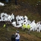 TOPSHOT - EDITORS NOTE: Graphic content / Members of the forensics team recover the bodies of victims of the LAMIA airlines charter plane crash in the mountains of Cerro Gordo, municipality of La Union, on November 29, 2016. A charter plane carrying the Chapecoense Real football team crashed in the mountains in Colombia late Monday, killing as many as 75 people, officials said. / AFP / RAUL ARBOLEDA (Photo credit should read RAUL ARBOLEDA/AFP/Getty Images)