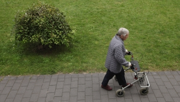 BERLIN, GERMANY - AUGUST 30: An elderly woman pushes a walker along a path in the gardens of the Sewanstrasse senior care home in Lichtenberg district on August 30, 2011 in Berlin, Germany. The center is participating in Senior Citizens' Week (Berliner Seniorenwoche), a city initiative meant to highlight activities available for the city's eldery. Germany is facing significant demographic change that includes elderly citizens making up an increasing portion of the overall population, a situation aggravated by the country's birth rate, which is the lowest in Europe. The shift will continue to put greater strain on the country's ability to finance its public health and senior care programs. (Photo by Sean Gallup/Getty Images)