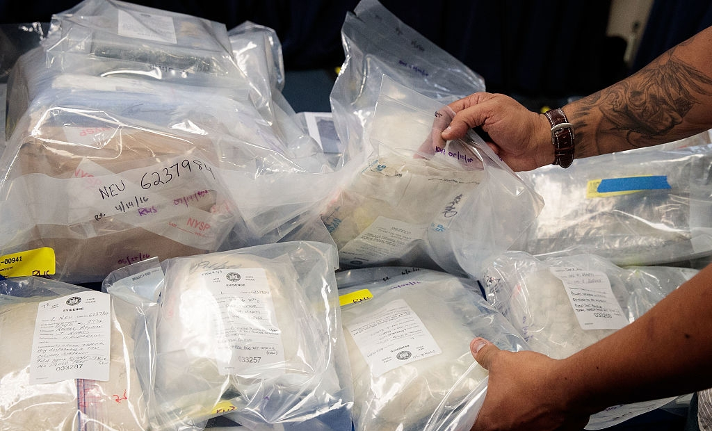 NEW YORK, NEW YORK - SEPTEMBER 23: A law enforcement official organizes bags of heroin to be displayed before a press conference regarding a major drug bust, at the office of the New York Attorney General, September 23, 2016 in New York City. New York State Attorney General Eric Scheiderman's office announced Friday that authorities in New York state have made a record drug bust, seizing 33 kilograms of heroin and 2 kilograms of fentanyl. According to the attorney general's office, it is the largest seizure in the 46 year history of New York's Organized Crime Task Force. Twenty-five peopole living in New York, Massachusetts, Pennsylvania, Arizona and New Jersey have been indicted in connection with the case. (Photo by Drew Angerer/Getty Images)