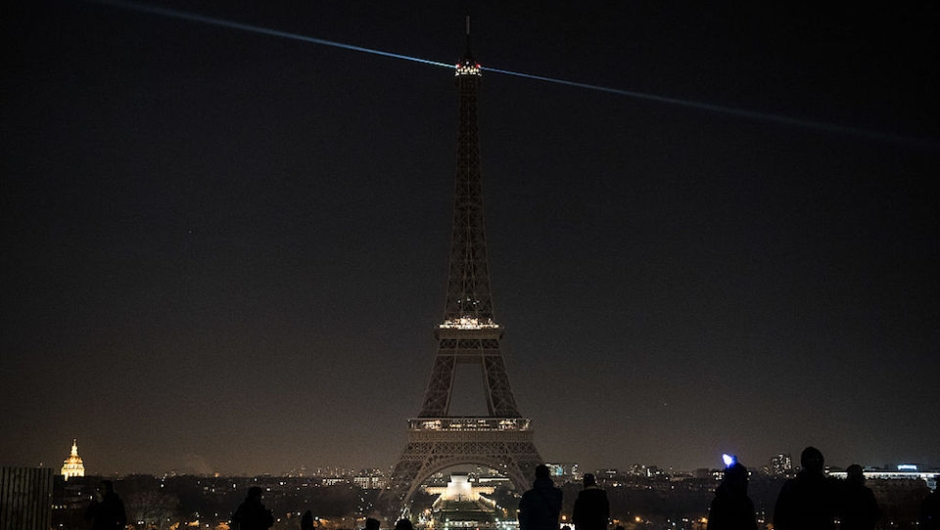 The lights of the Eiffel Tower are exceptionally switched off in Paris, on December 14, 2016, in support of the Syrian city of Aleppo. Shelling and air strikes sent terrified residents running through the streets of Aleppo on December 14, 2016 as diplomats strove to save a deal to evacuate the shrinking rebel-held districts of the city. / AFP / PHILIPPE LOPEZ (Photo credit should read PHILIPPE LOPEZ/AFP/Getty Images)