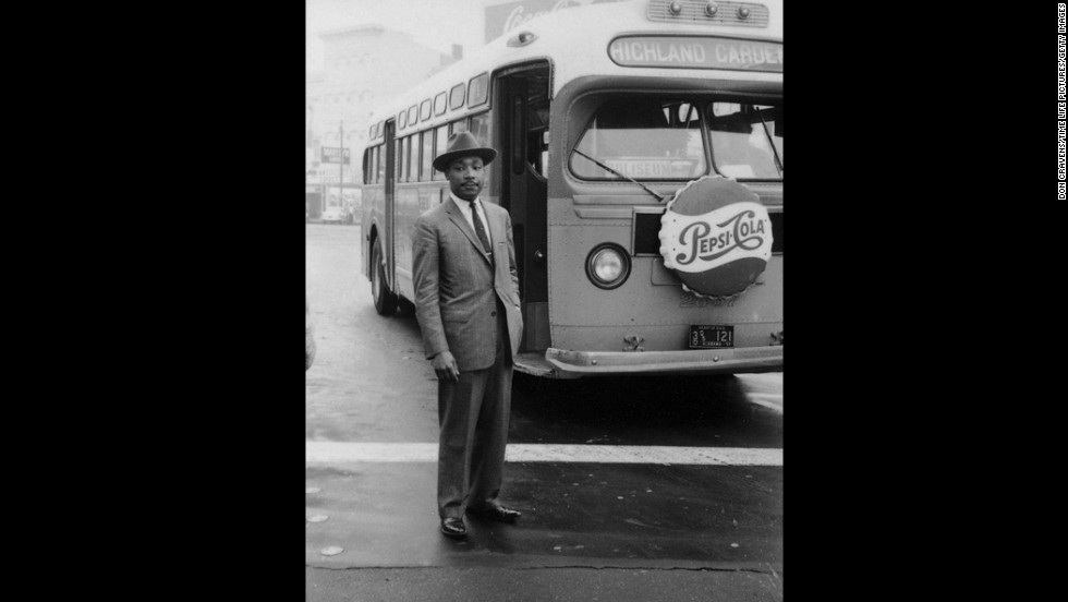 American Civil Rights leader Reverend Martin Luther King Jr.(1929 - 1968) stands in front of a bus at the end of the Montgomery bus boycott, Montgomery, Alabama, December 26, 1956. (Photo by Don Cravens/Time Life Pictures/Getty Images)