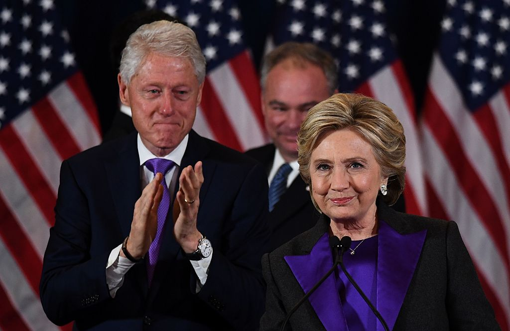TOPSHOT - US Democratic presidential candidate Hillary Clinton makes a concession speech after being defeated by Republican president-elect Donald Trump as former President Bill Clinton(L) and running mate Tim Kaine look on in New York on November 9, 2016. / AFP / JEWEL SAMAD (Photo credit should read JEWEL SAMAD/AFP/Getty Images)
