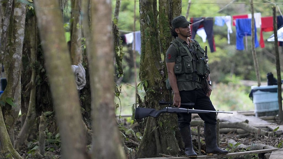"""FARC guerrilla fighters stand at the Front 34 Alberto Martinez encampment after the New Year's celebration in Vegaez municipality, Antioquia department, Colombia on January 1, 2017. Colombia's Congress on Wednesday passed a law granting an amnesty to the Marxist FARC rebels as part of the country's peace deal, a development the government hailed as """"historic."""" / AFP / STR / RAUL ARBOLEDA (Photo credit should read RAUL ARBOLEDA/AFP/Getty Images)"""