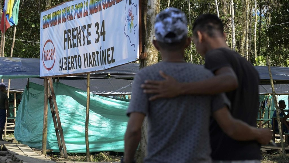 """FARC guerrilla fighters walk in the Front 34 Alberto Martinez encampment after the New Year's celebration in Vegaez municipality, Antioquia department, Colombia on January 1, 2017. Colombia's Congress on Wednesday passed a law granting an amnesty to the Marxist FARC rebels as part of the country's peace deal, a development the government hailed as """"historic."""" / AFP / STR / RAUL ARBOLEDA (Photo credit should read RAUL ARBOLEDA/AFP/Getty Images)"""