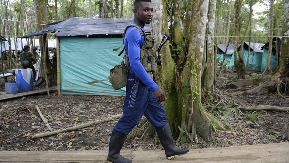 """FARC guerrilla fighter Yeiler Cuesta walks in the Front 34 Alberto Martinez encampment after the New Year's celebration in Vegaez municipality, Antioquia department, Colombia on January 1, 2017. Colombia's Congress on Wednesday passed a law granting an amnesty to the Marxist FARC rebels as part of the country's peace deal, a development the government hailed as """"historic."""" / AFP / STR / RAUL ARBOLEDA (Photo credit should read RAUL ARBOLEDA/AFP/Getty Images)"""
