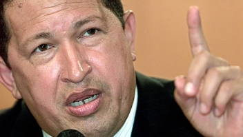 """CARACAS, VENEZUELA: (FILES) Picture of Venezuelan President Hugo Chavez taken in Caracas, 13 February 2004. Mexican authorities accused Venezuela 15 November 2005 of becoming a major new transit point for illegal heroin trafficking, heightening a war of words after the withdrawal of their ambassadors. Venezuela angrily rejected Mexico's demand that it apologize for statements by Chavez, who has called the Mexican president """"a lapdog"""" of the United States. The row started after Fox criticized Chavez's stance at last week's Summit of the Americas in Argentina. AFP PHOTO/Andrew ALVAREZ (Photo credit should read ANDREW ALVAREZ/AFP/Getty Images)"""