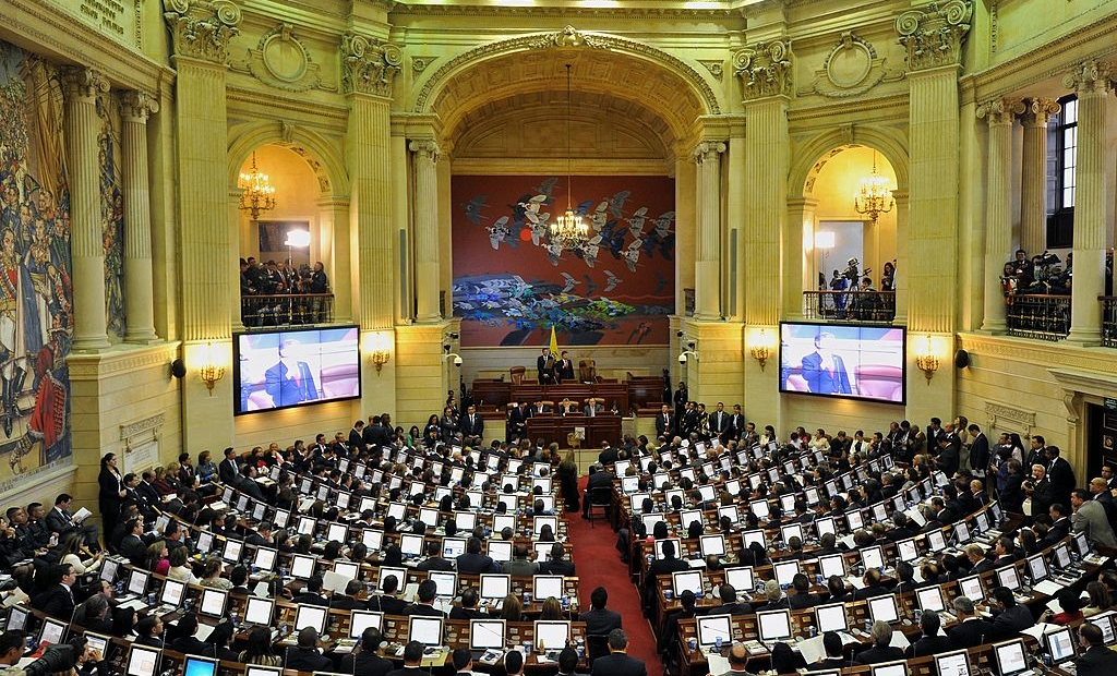 """General view during the installation of the new Congress (2014-2018) at the Capitol in Bogota, Colombia, on July 20, 2014. Colombian President Juan Manuel Santos settled on Sunday which he called the Congress of peace and called on lawmakers to support the task to carry out the agreements and rules for a """"post-conflict nation."""" AFP PHOTO/Guillermo Legaria (Photo credit should read GUILLERMO LEGARIA/AFP/Getty Images)"""