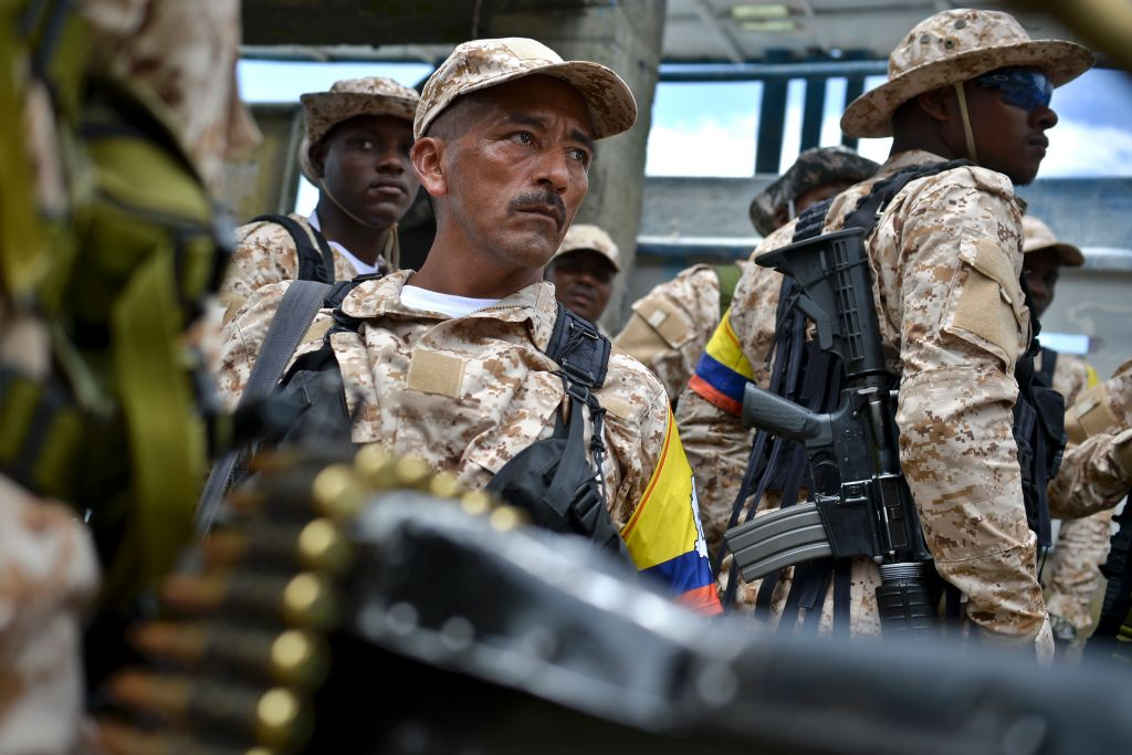 Members of the FARC guerrilla disembark in Buenaventura, Colombia, on February 4, 2017, from where they will go Sunday to UN-monitored transitional zones to hand in their weapons. Colombian FARC rebels started a historic disarmament process to end Latin America's last major armed conflict. / AFP / LUIS ROBAYO (Photo credit should read LUIS ROBAYO/AFP/Getty Images)