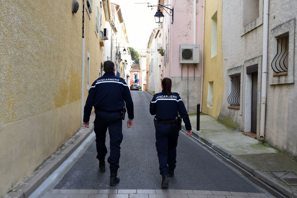 Gendarmes patrol in a street in Marseillan, about 40 kilometres southwest from Montpellier, southern France, on February 10, 2017, where suspects believed to be involved in plotting an attack were arrested by French anti-terrorist police (RAID). Four people including a 16-year-old girl were arrested on February 10 by anti-terrorist police in Montpellier on suspicion of preparing an attack, a police source said. The other suspects were aged 20, 26 and 33, according to the source. The four were arrested after buying acetone, a highly flammable liquid that can be used to make bombs. France remains on high alert after a wave of attacks which began two years ago that has claimed more than 200 lives.  / AFP / SYLVAIN THOMAS        (Photo credit should read SYLVAIN THOMAS/AFP/Getty Images)