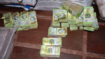 "Picture of 50-Venezuelan Bolivar bills, part of a hoard weighing about 30 tons seized by Paraguay's National Police at a house in Salto del Guaira, department of Canindeyu in the border with Brazil, about 420 km east of Asuncion, on February 14, 2017. In January Venezuela released new bigger denomination banknotes as President Nicolas Maduro wanted to scrap the 100-bolivar note, claiming they are being hoarded by ""mafias."" / AFP / STR (Photo credit should read STR/AFP/Getty Images)"