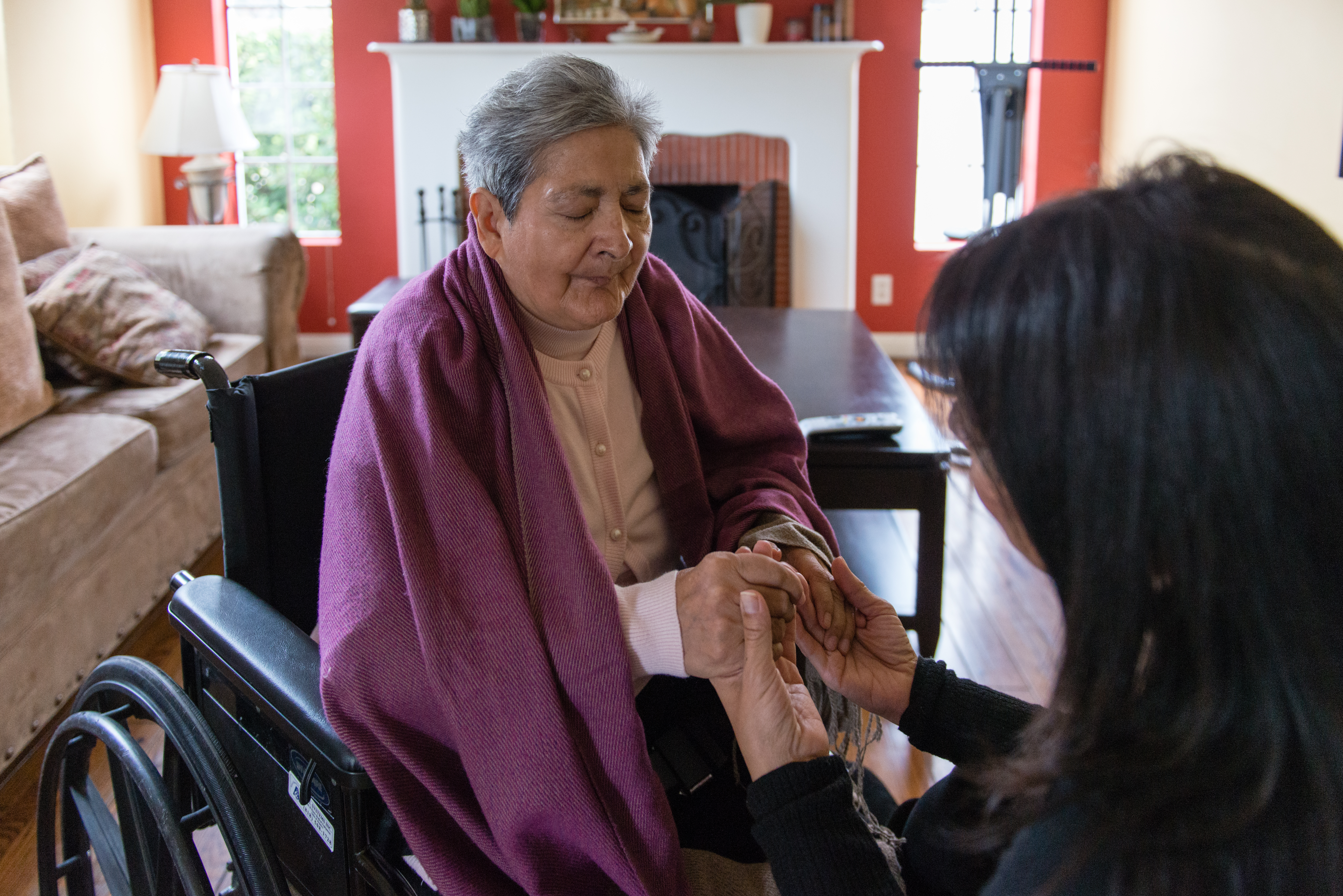 ania Yanes sits with mother, Blanca Rose Rivera, in her living room in North Hollywood, Calif., on Sunday, November 27, 2016. (Heidi de Marco/KHN)