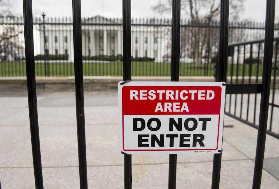 A security fence is seen around the perimeter of the White House in Washington, DC, March 18, 2017. A man who scaled a White House fence earlier this month traipsed the grounds of the executive residence for more than 16 minutes prior to his arrest, the US Secret Service said. / AFP PHOTO / SAUL LOEB (Photo credit should read SAUL LOEB/AFP/Getty Images)