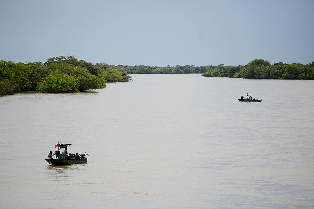 enezuelan Marine Corps patrol the bordering Arauca river, in the Venezuelan state of Apure on August 9, 2013 after Venezuela and Colombia signed border agreements. AFP PHOTO / Leo RAMIREZ (Photo credit should read LEO RAMIREZ/AFP/Getty Images)