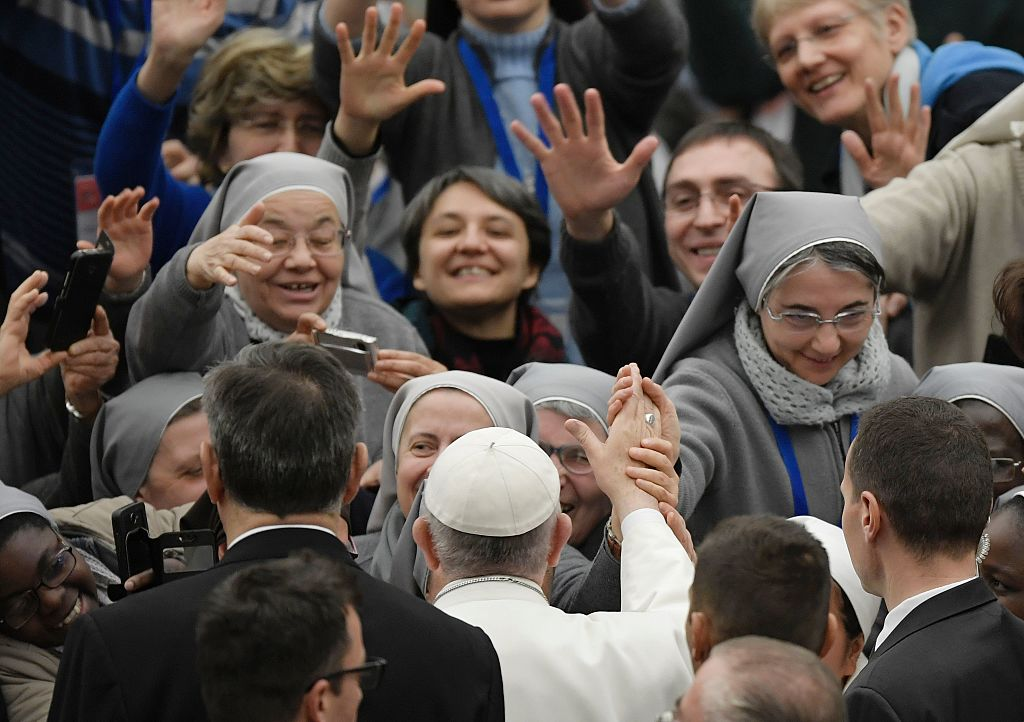 Pope Francis greets nuns during an audience to the participants in the national Office for Pastoral Care for Vocations of the Italian Episcopal Conference at the Paul VI audience Hall on January 5, 2017 in Vatican. / AFP / Tiziana FABI (Photo credit should read TIZIANA FABI/AFP/Getty Images)
