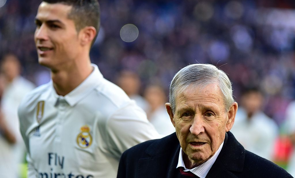 Former French football player Raymond Kopa (R) looks on past Real Madrid's Portuguese forward Cristiano Ronaldo during the handover ceremony of Ronaldo's four Ballon d'Or before the Spanish league football match Real Madrid CF vs Granada FC at the Santiago Bernabeu stadium in Madrid on January 7, 2017. Real Madrid won 5-0. / AFP / GERARD JULIEN (Photo credit should read GERARD JULIEN/AFP/Getty Images)