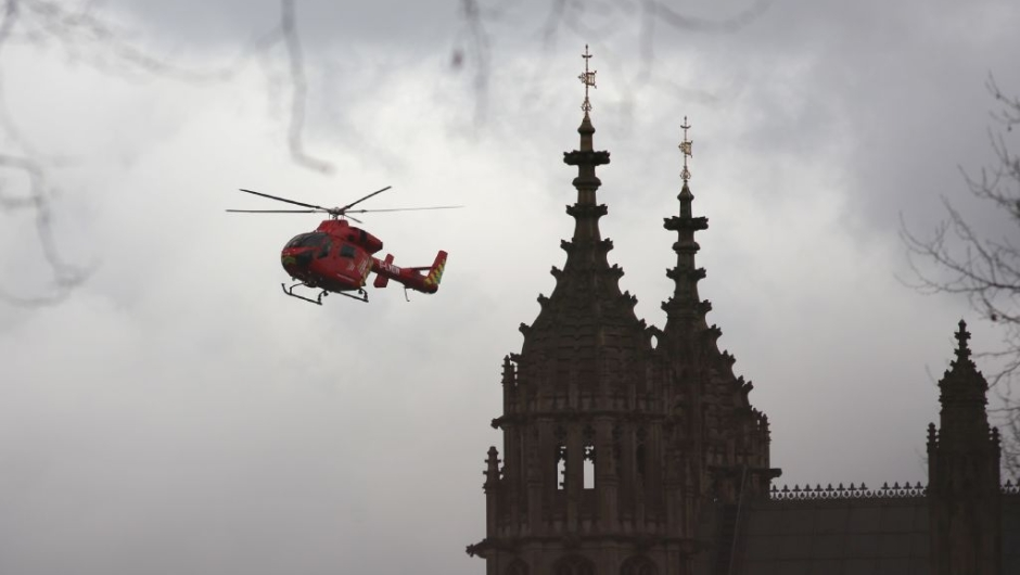 London's air ambulance arrives at the Houses of Parliament in central London on March 22, 2017 during an emergency incident. Britain's Houses of Parliament were in lockdown on Wednesday after staff said they heard shots fired, triggering a security alert. / AFP PHOTO / DANIEL LEAL-OLIVAS (Photo credit should read DANIEL LEAL-OLIVAS/AFP/Getty Images)