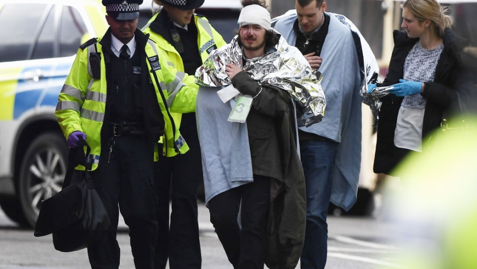 ONDON, ENGLAND - MARCH 22: A member of the public is treated by emergency services near Westminster Bridge and the Houses of Parliament on March 22, 2017 in London, England. A police officer has been stabbed near to the British Parliament and the alleged assailant shot by armed police. Scotland Yard report they have been called to an incident on Westminster Bridge where several people have been injured by a car. (Photo by Carl Court/Getty Images)