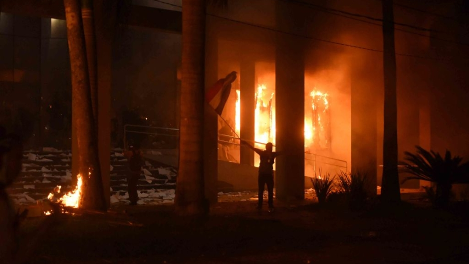 Hundreds of demonstrators protesting against the approval of a constitutional amendment for presidential reelection broke into the Congress building, battering down entrances and fences and shattering windows, and started to set fires inside, in Asuncion on March 31, 2017. Paraguayan senators on Friday approved a contested law allowing President Horacio Cartes to seek reelection in 2018, prompting furious protesters to break into the legislature, ransacking lawmakers' offices and starting fires. / AFP PHOTO / NORBERTO DUARTE (Photo credit should read NORBERTO DUARTE/AFP/Getty Images)