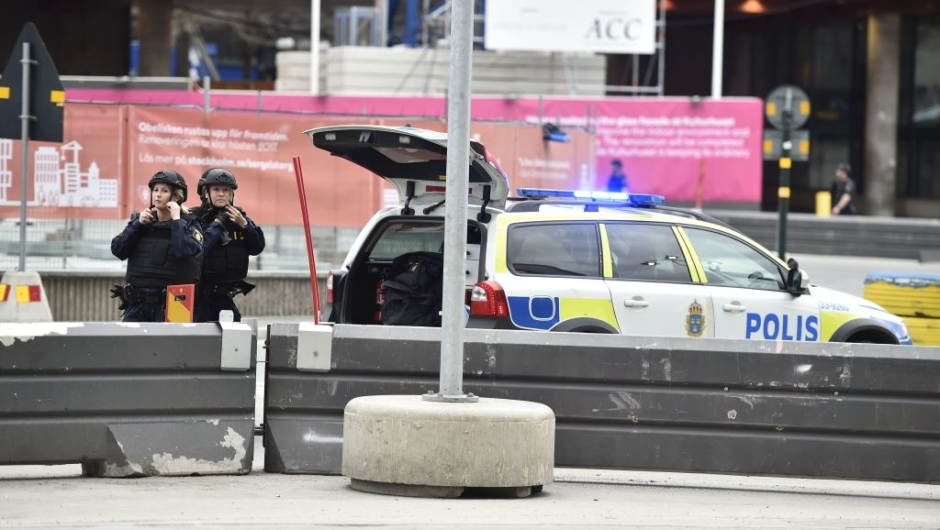 Police officers work at the scene where a truck crashed into the Ahlens department store at Drottninggatan in central Stockholm, April 7, 2017. / AFP PHOTO / TT News Agency / Noella JOHANSSON / Sweden OUT (Photo credit should read NOELLA JOHANSSON/AFP/Getty Images)