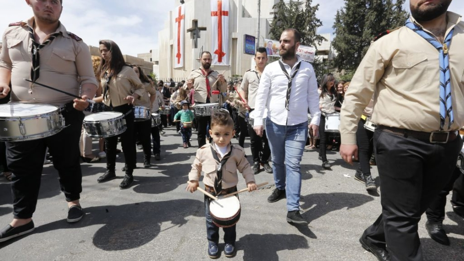 Syrian Christian Orthodox worshippers take part in a parade marking Palm Sunday at the Church of Saint Elias in the Syrian capital Damascus on April 9, 2017. Palm Sunday is the final Sunday of Lent, the beginning of the Holy Week, and commemorates the triumphant arrival of Jesus Christ in Jerusalem, days before he was crucified. / AFP PHOTO / Louai Beshara (Photo credit should read LOUAI BESHARA/AFP/Getty Images)
